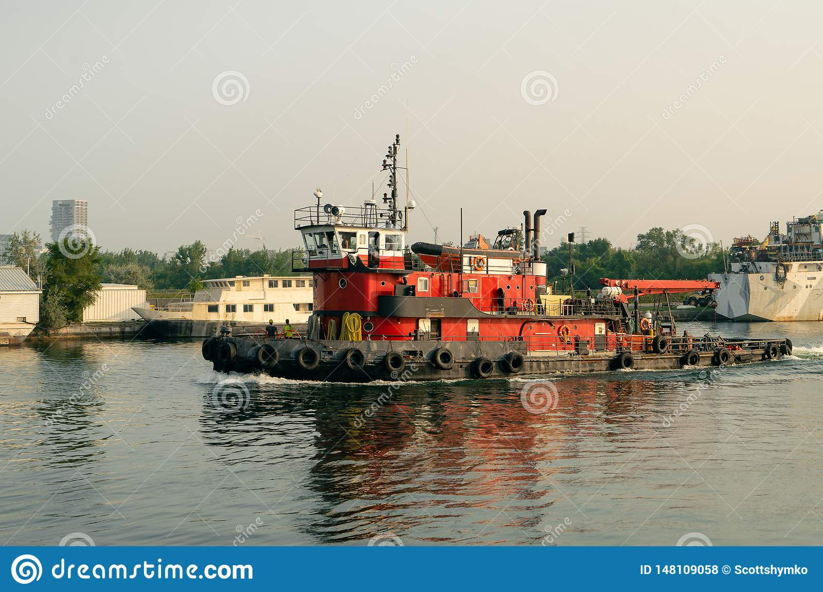 Tugboat sails out from harbor
