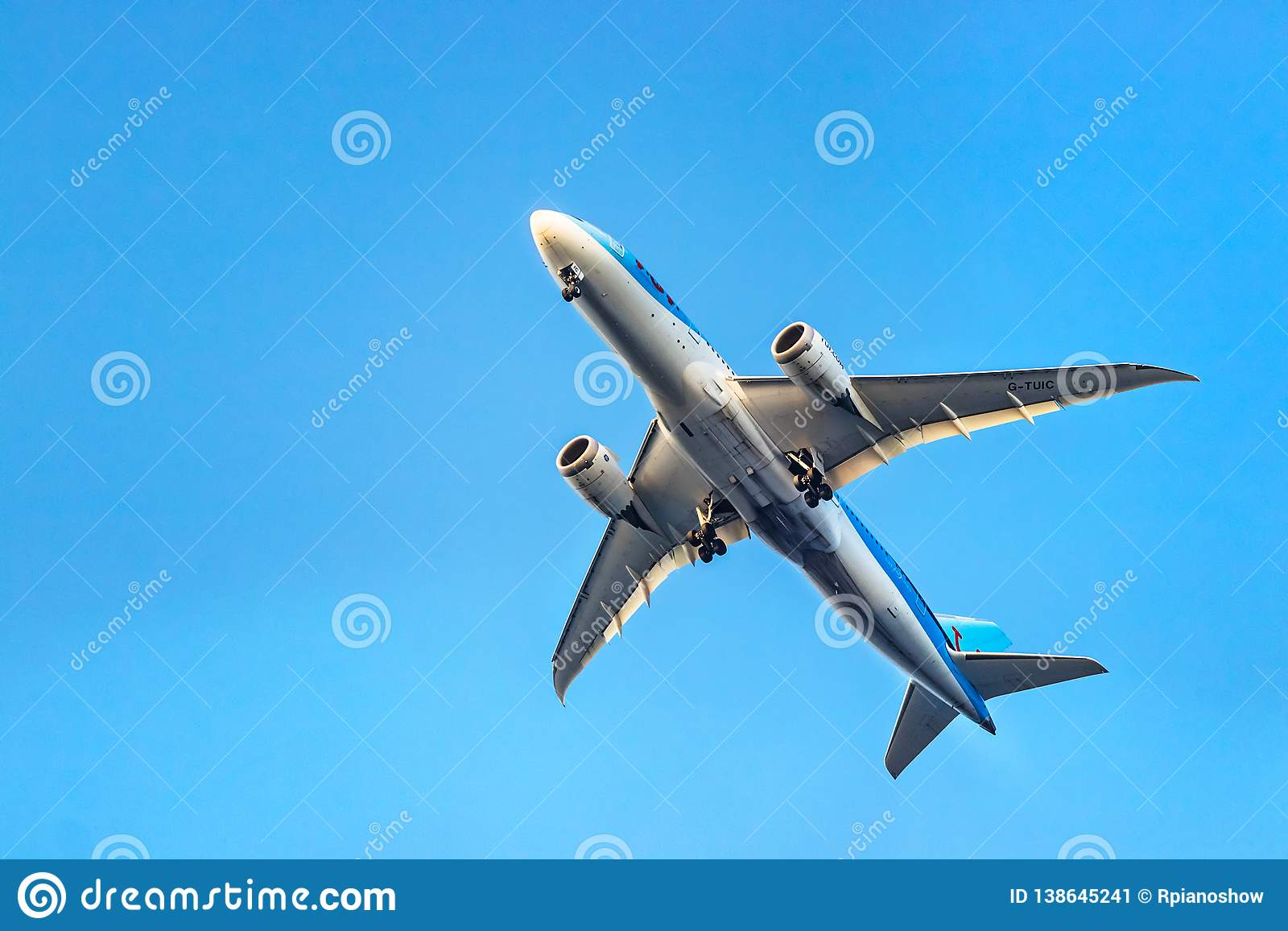 A TUI Airways Boeing 787-8 Dreamliner taking off below view at Rhodes, Greece