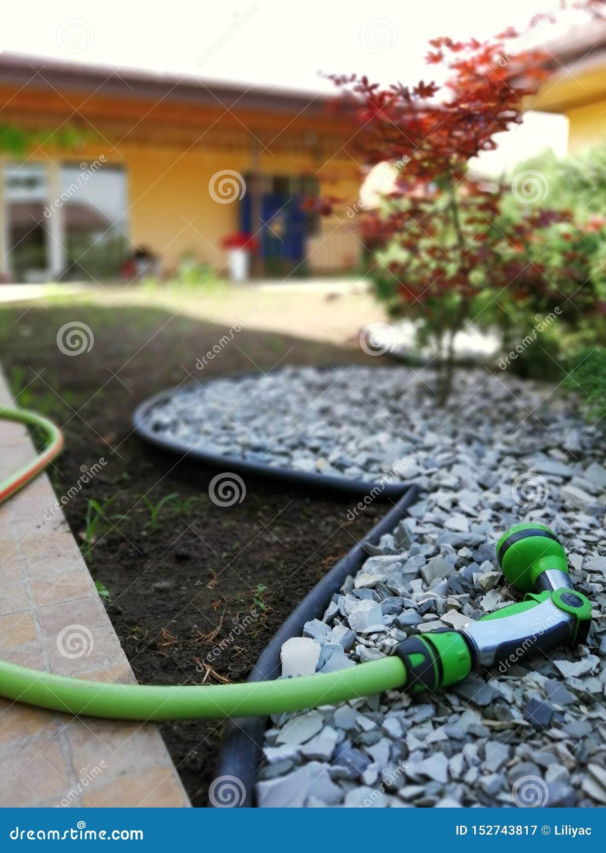 Tuinhulpmiddel om water te geven en zorg