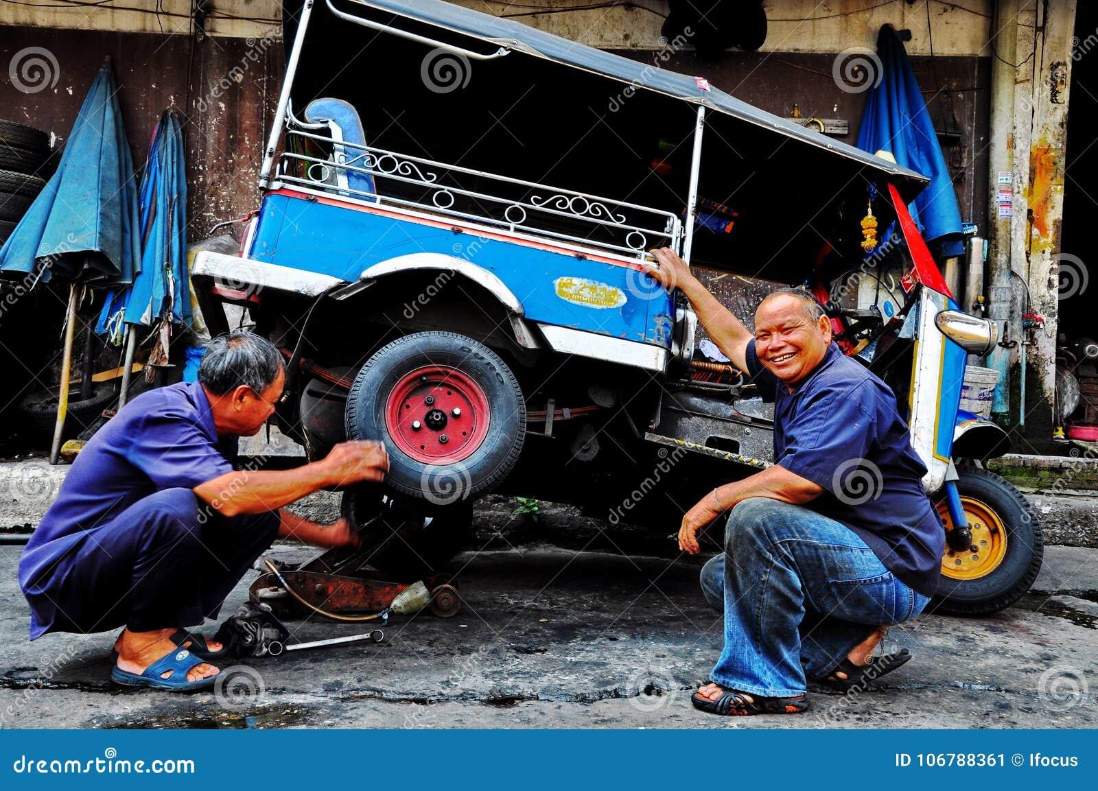 Tuk tuk mechanics in Bangkok