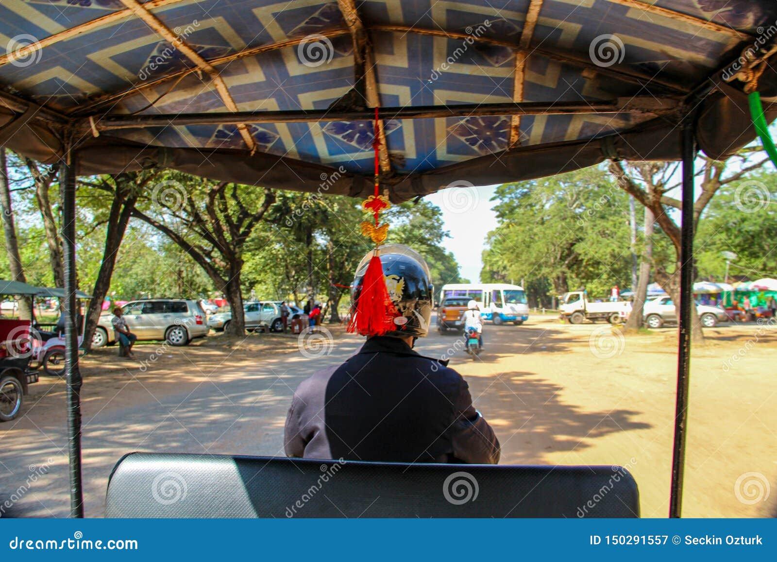 Tuk tukchaufför i Siem Reap, Asien