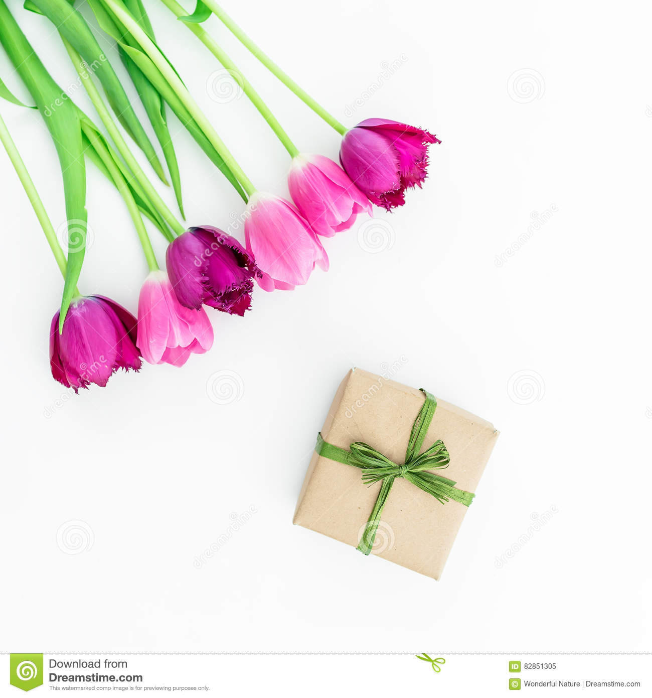 Tulip flowers and gift on white background flat lay top view royalty free stock photo negle Image collections