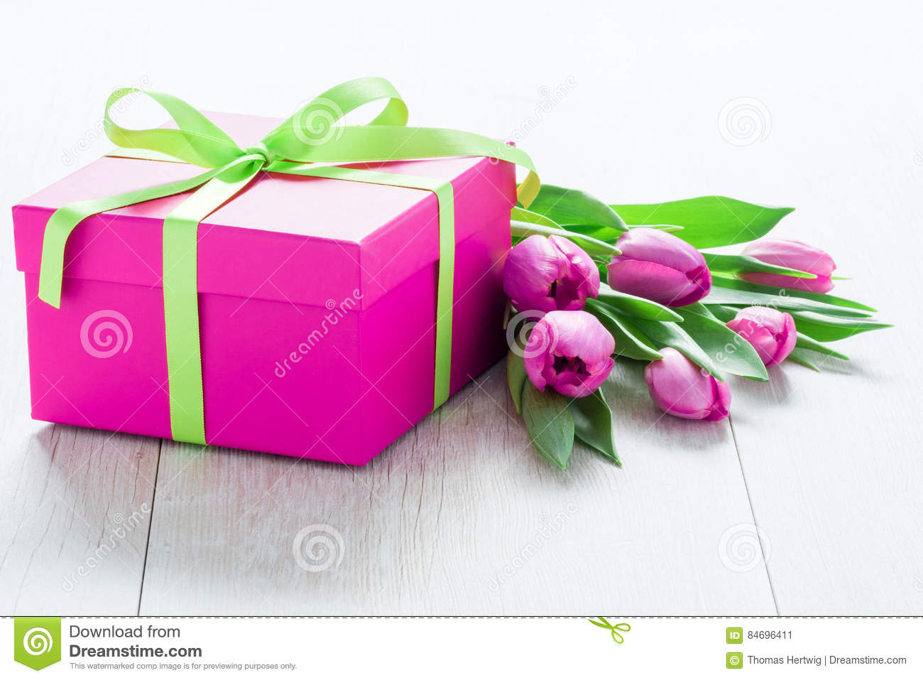 Tulip Flowers and Giftbox on rustic table for March 8, International Womens Day, Birthday , Valentines Day or Mothers day