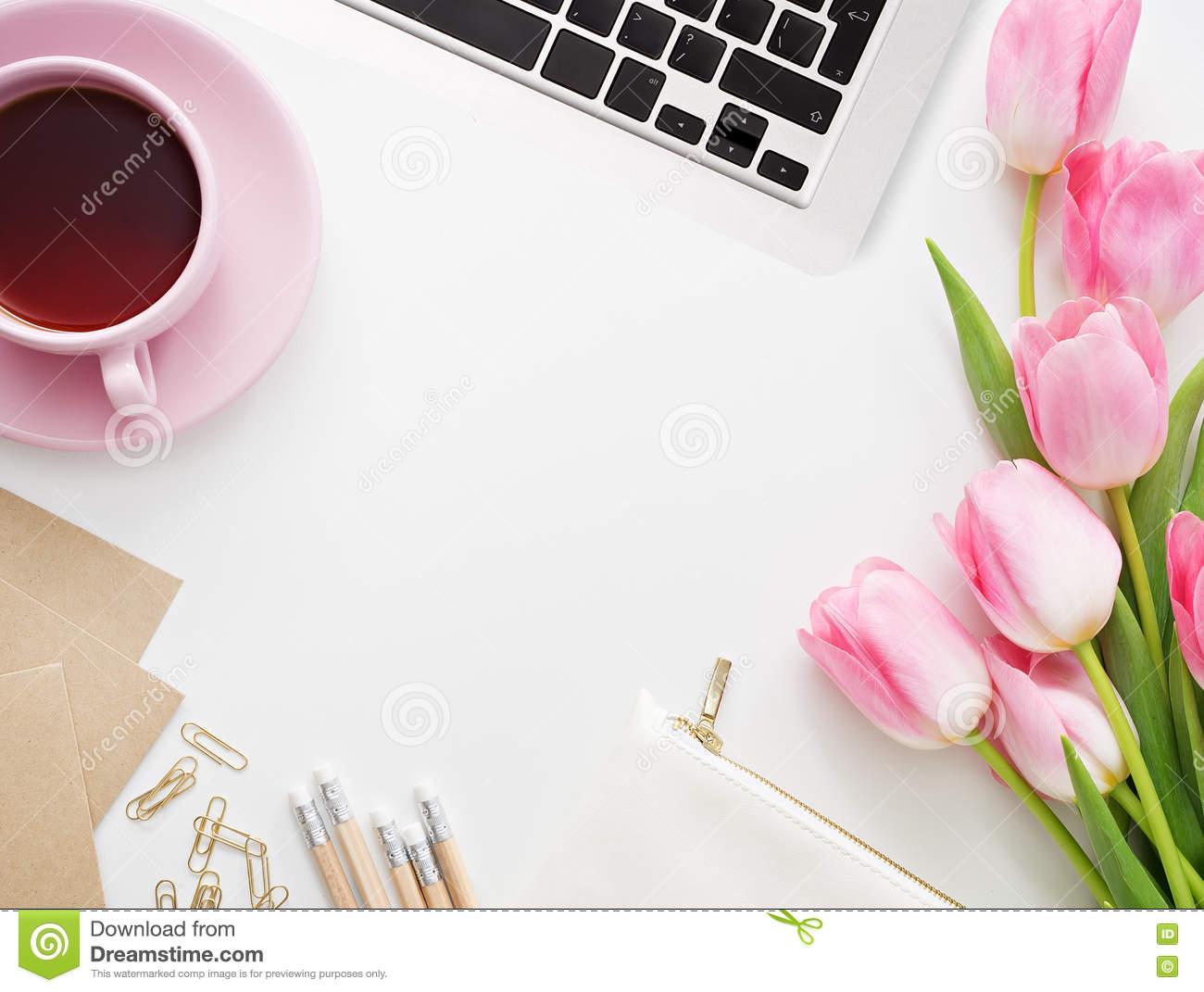 tulips, keyboard and office supplies on white board stock photo