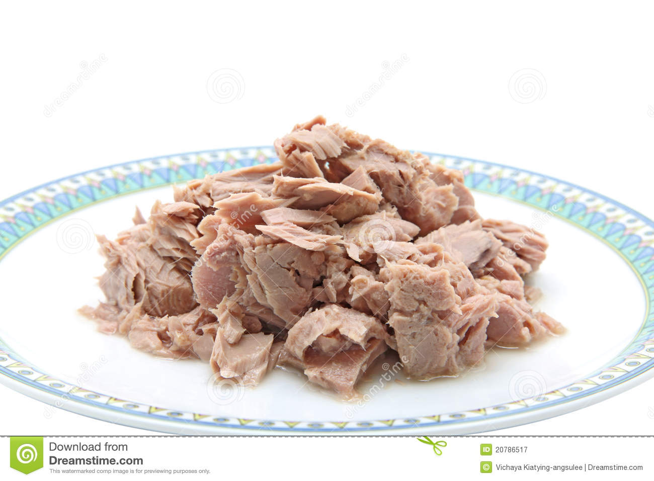 Tuna fish meat in dish for cooking isolated on white background.