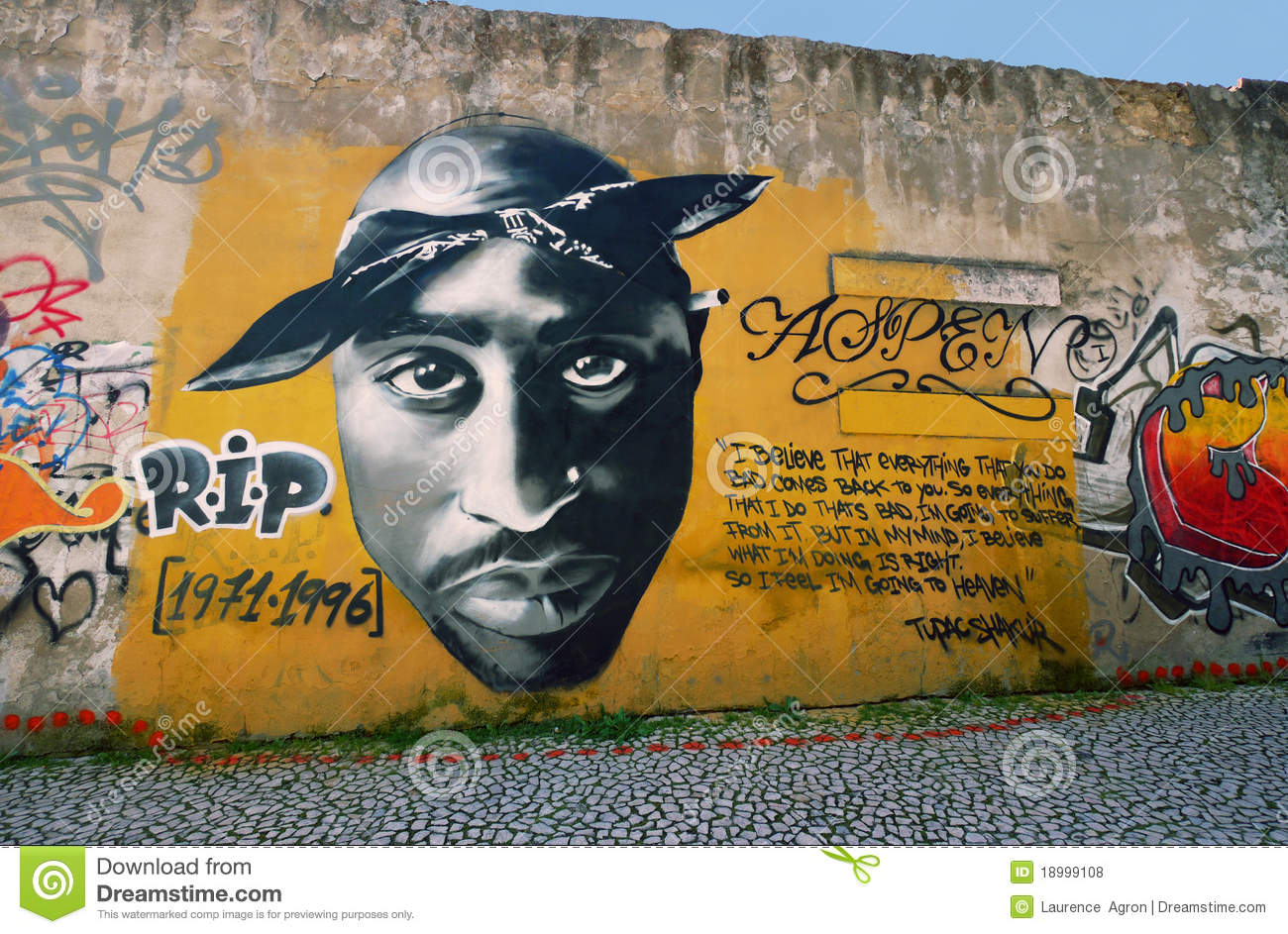 This wall graffiti in lisbon portugal celebrates the late rapper tupac shakur march 2011