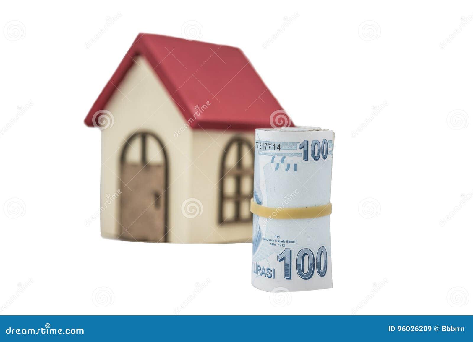 Tureckiego lira banknoty i mały drewniany dom