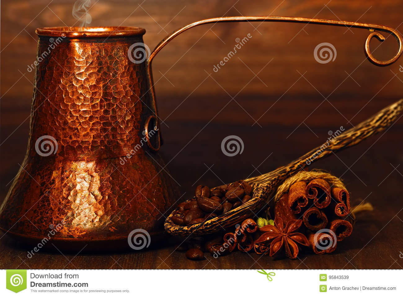 Turk coffee pot and coffee beans with spices on the table