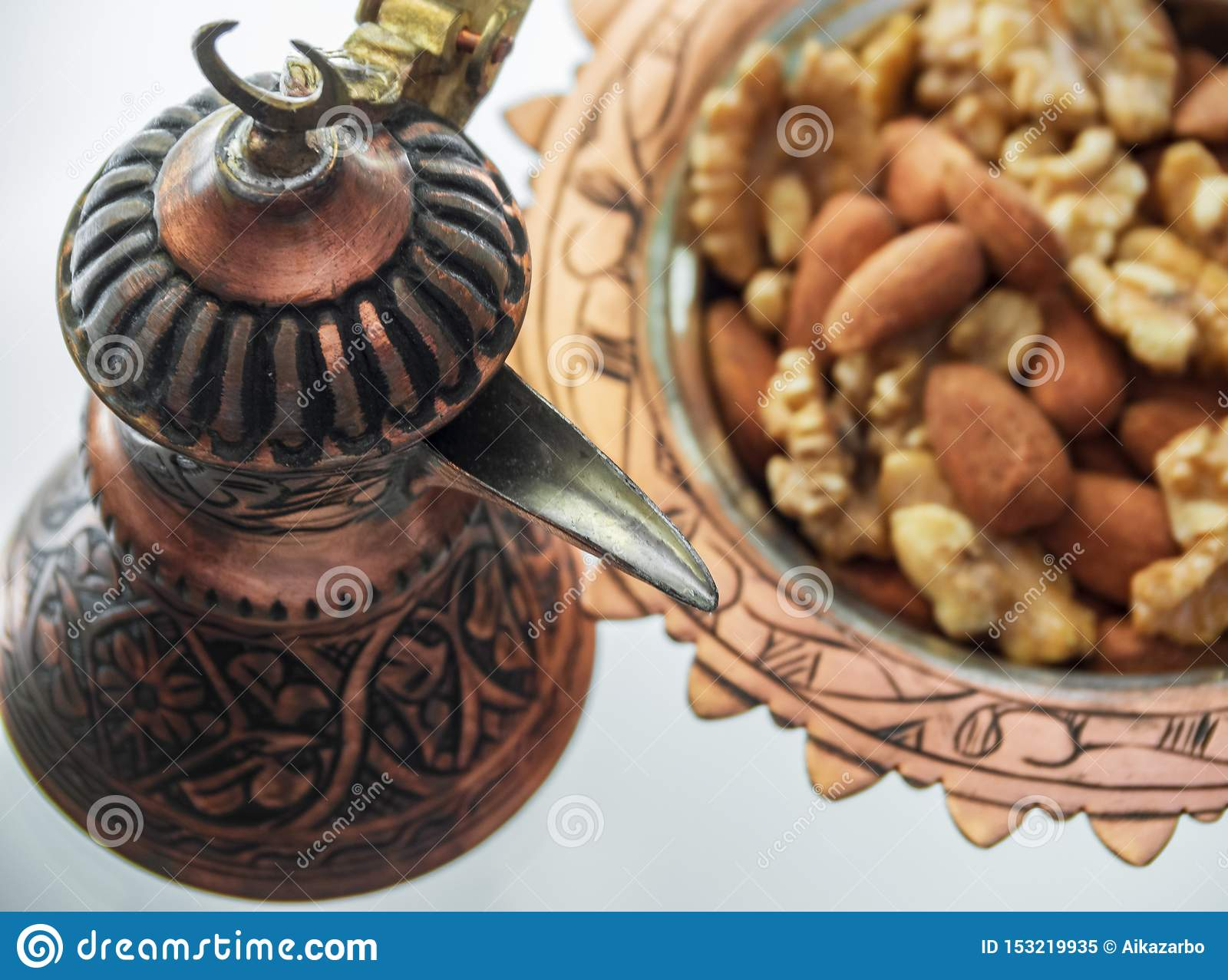 Turkish copper cookware handmade from Turks and candy dish with almonds and walnuts