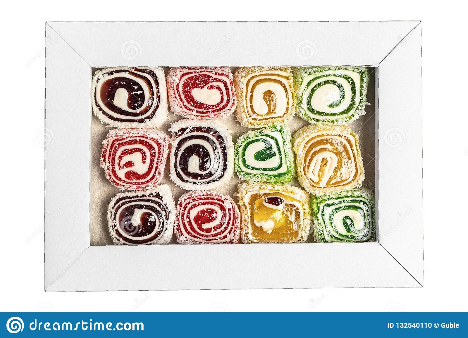 Turkish delight in the box isolated on a white background. Sweet candies in the box. Candy texture