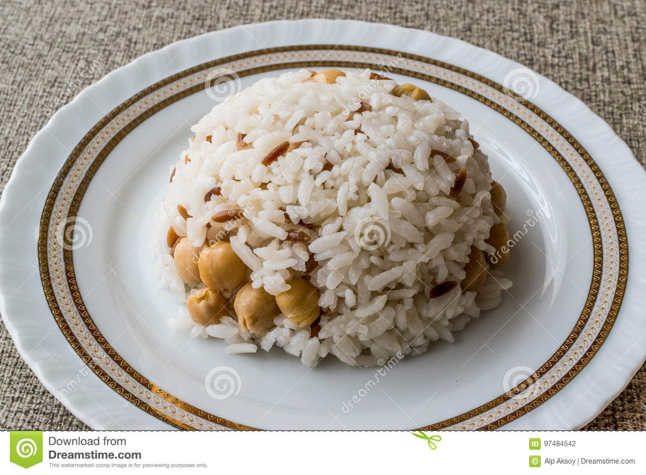 Turkish Rice with chickpea served with salt and pepper / Nohut Pilav. Dinner plate. & Turkish Rice With Chickpea Served With Salt And Pepper / Nohut Pilav ...