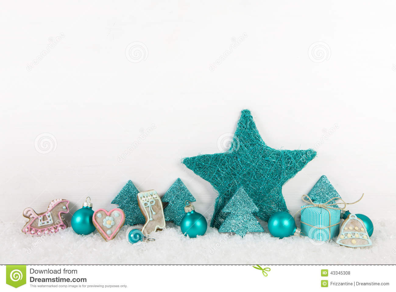 turquoise christmas decoration on wooden background with snow