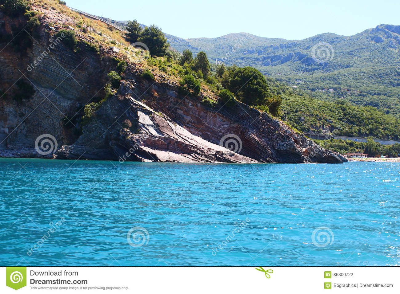 Download Turquoise Sea Meets The Mountain Stock Photo - Image of slope, mountains: 86300722