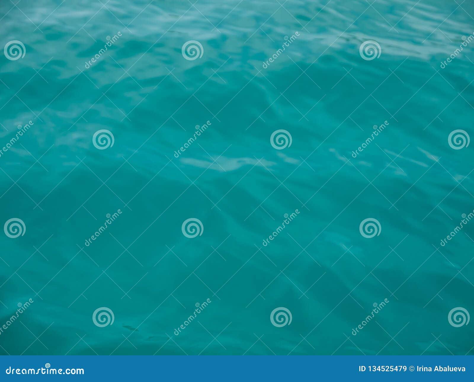 Turquoise sea wave splashing overboard