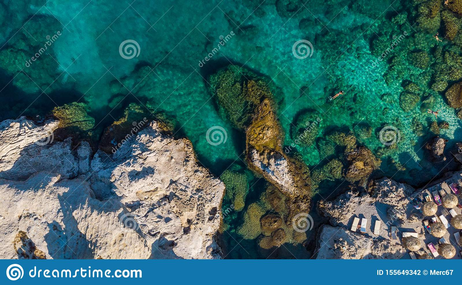 Turquoise Water and Rocky Shore on Greek Island, Aerial top Down View