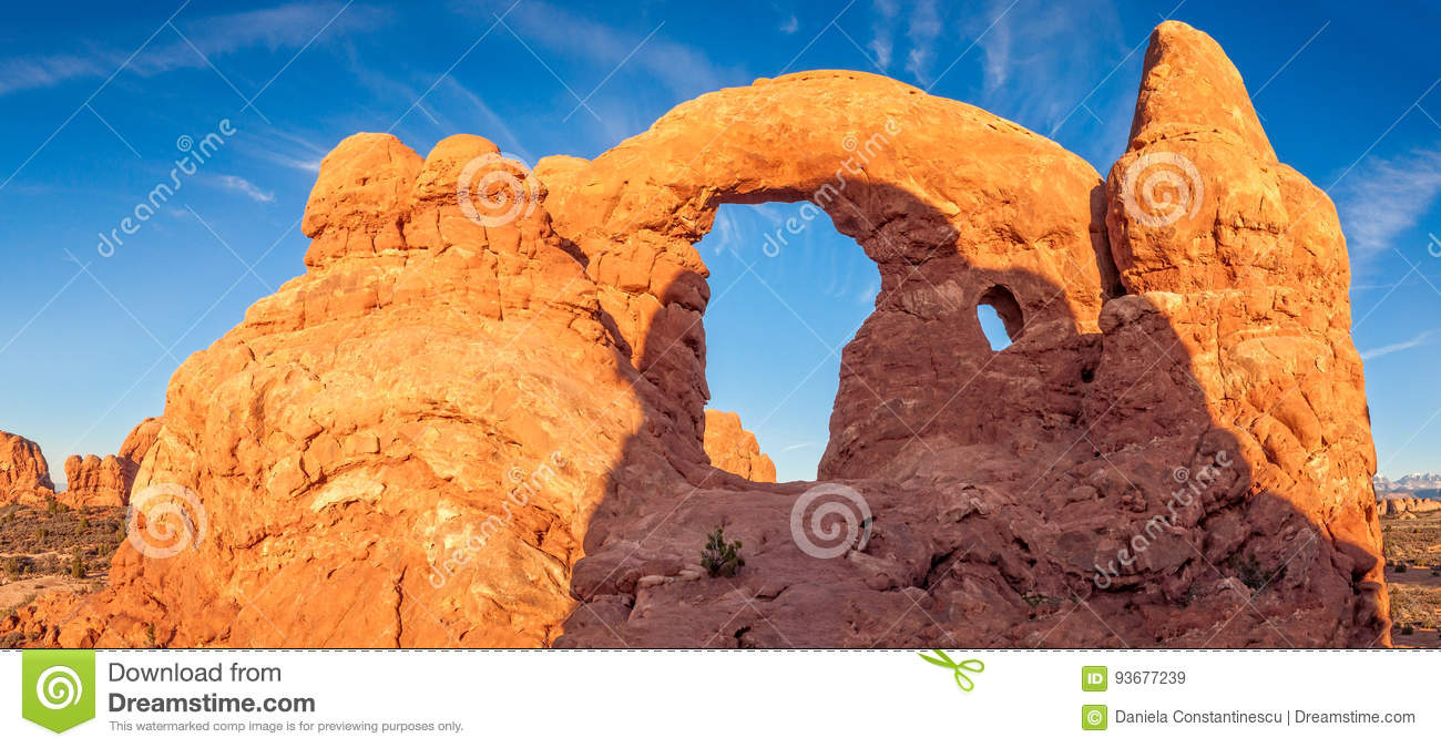 Turret Arch against the blue sky close to sunset at Arches National Park