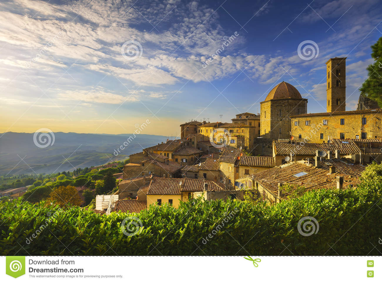 Tuscany, Volterra town skyline, church and panorama view on suns