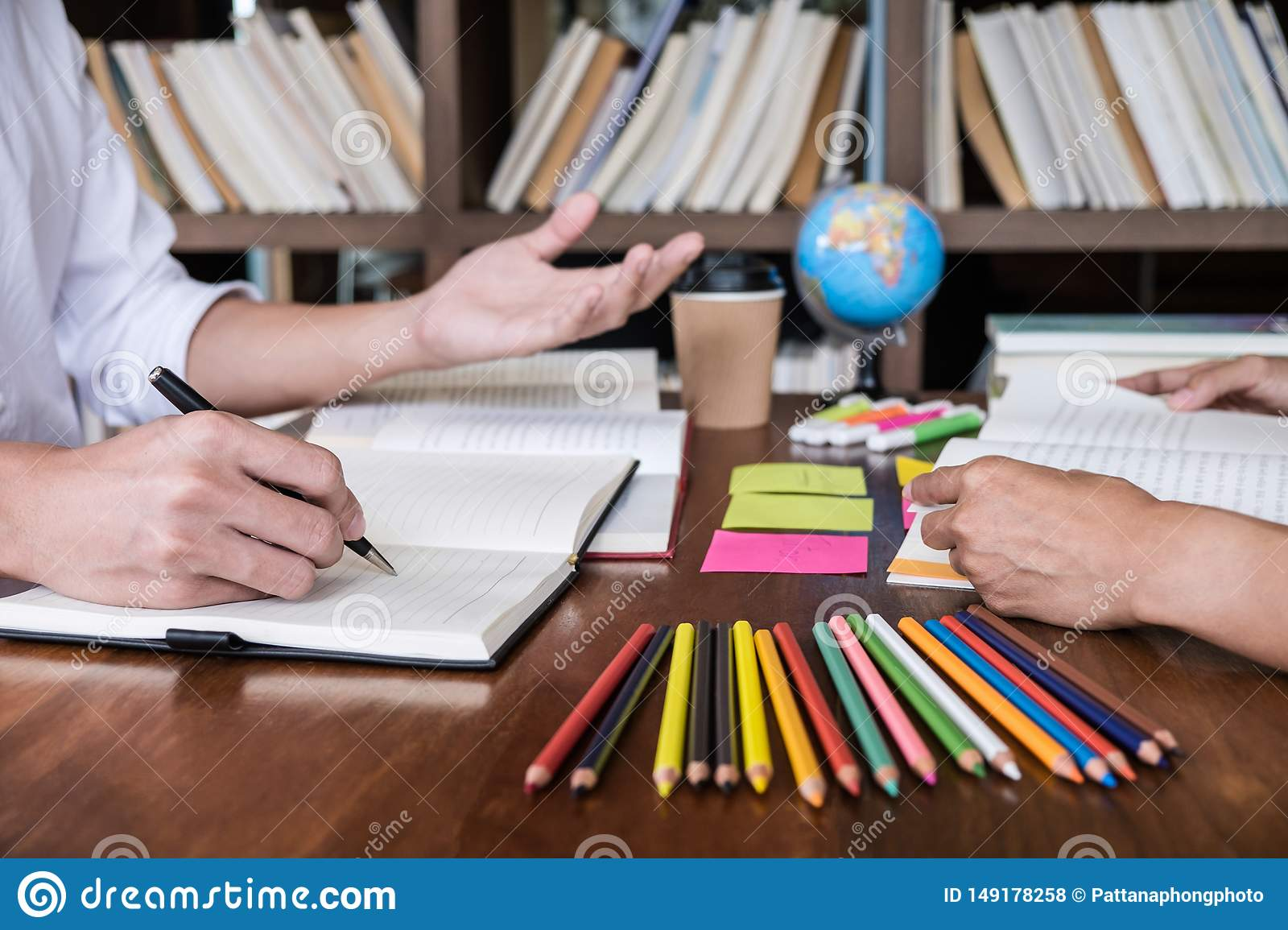 Tutor books with friends, Young students campus or classmates helps friend catching up workbook and learning tutoring in classroom