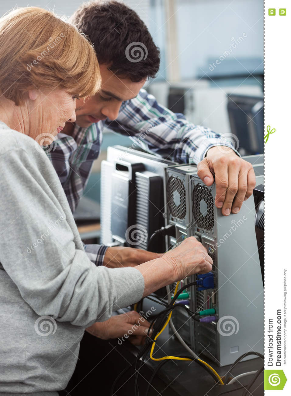 Tutor And Senior Student Fixing Computer In Class Stock Photo Technology Computers Classroom Parts