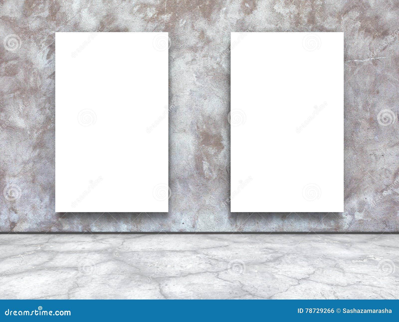 Två tomma affischer på betongväggen