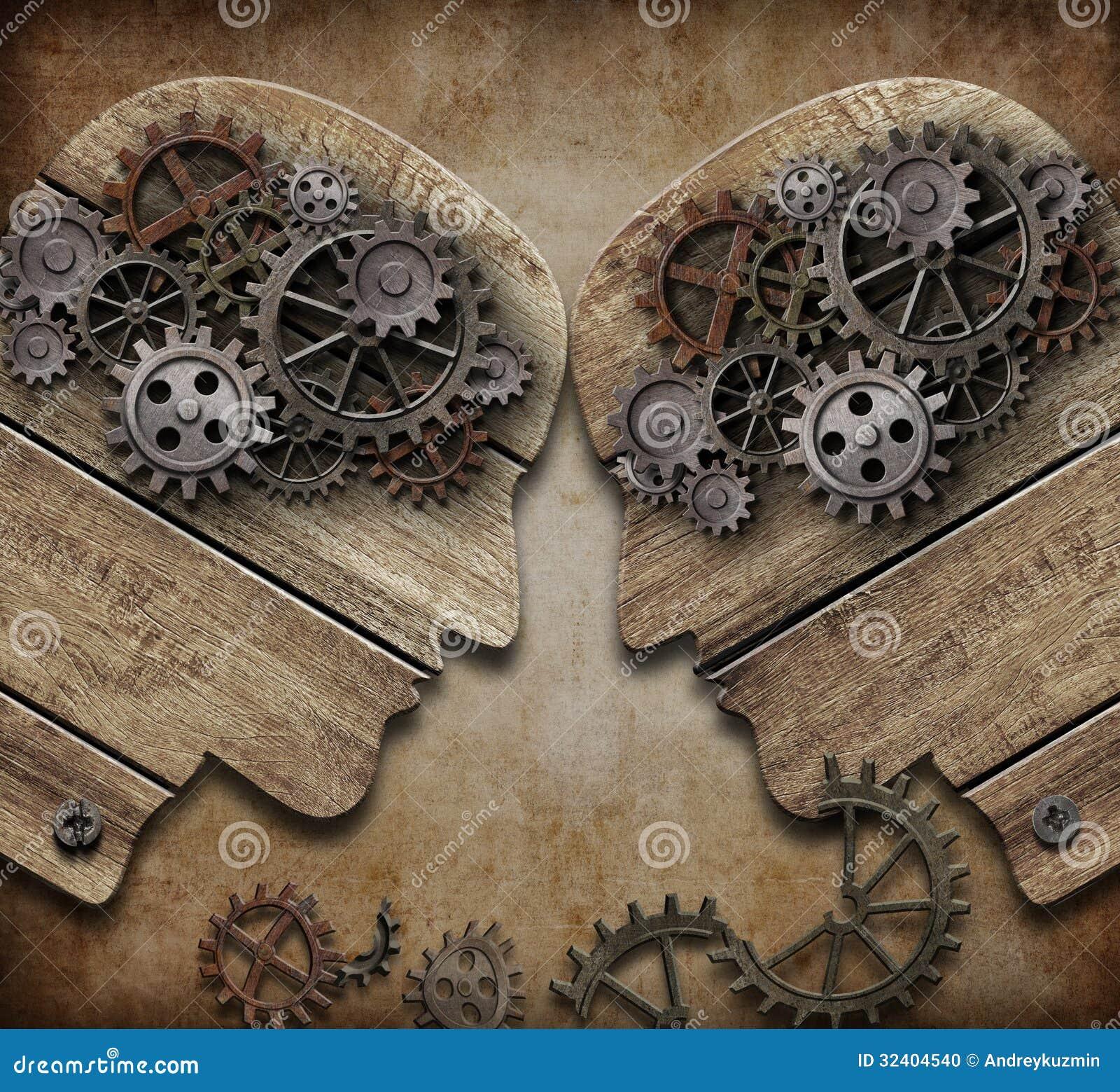 Två trähuvud med kugghjul som kommer in i sammanstötningsbegrepp