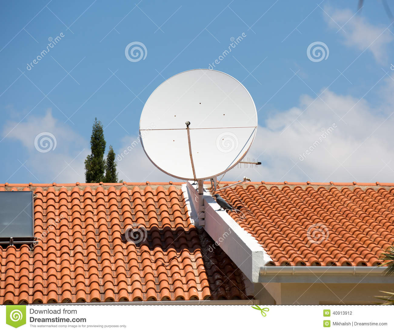 Tv antenna on the red tile roof