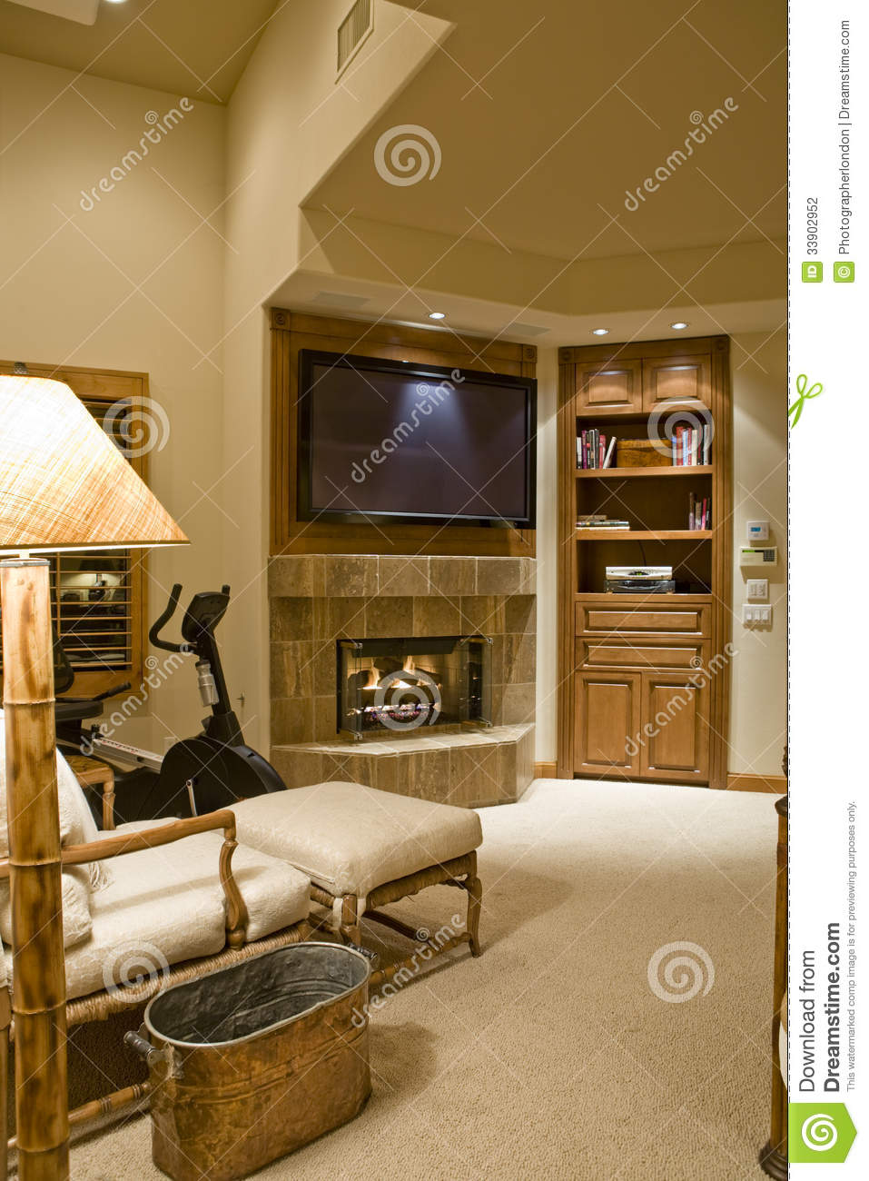 living room with tv and fireplace tv fireplace with reclining chair in foreground stock 25682