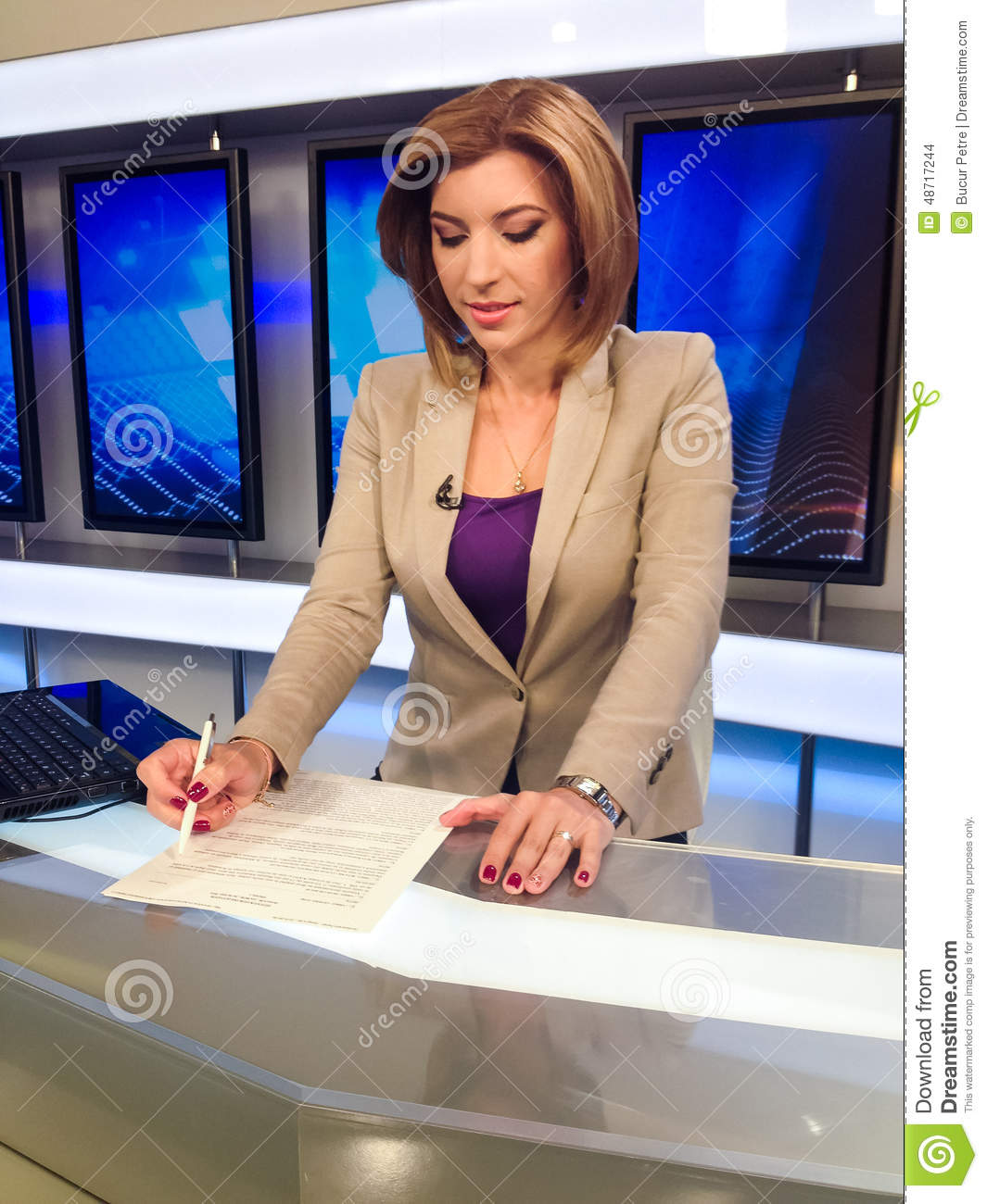 Download TV Reporter At The News Desk Stock Photo