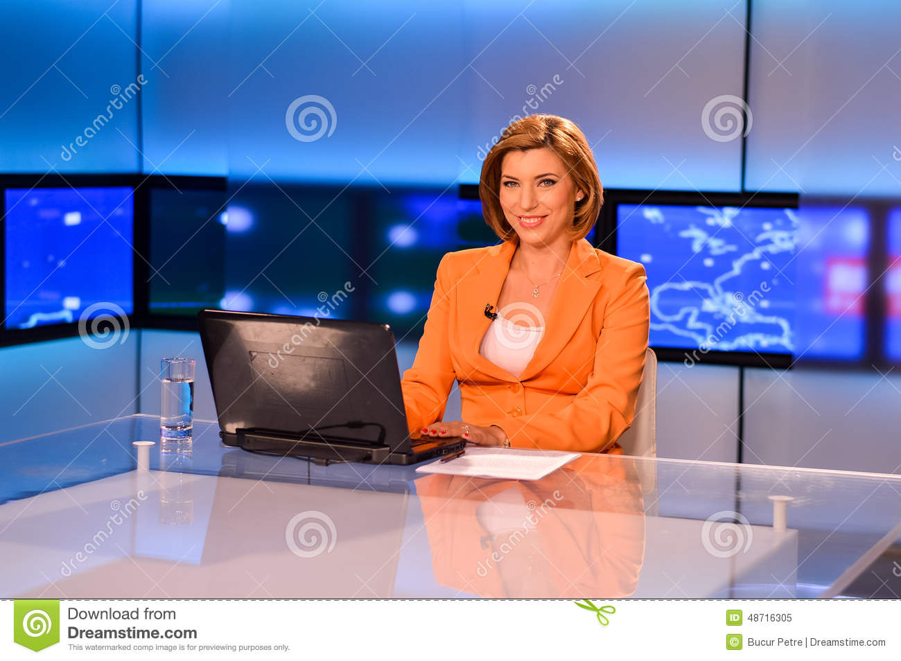 TV Reporter At The News Desk Presenting