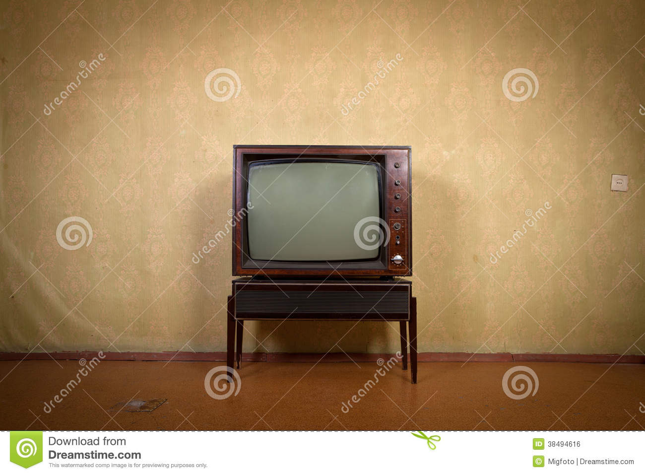 Retro TV on a background of vintage wallpaper in old room with ...