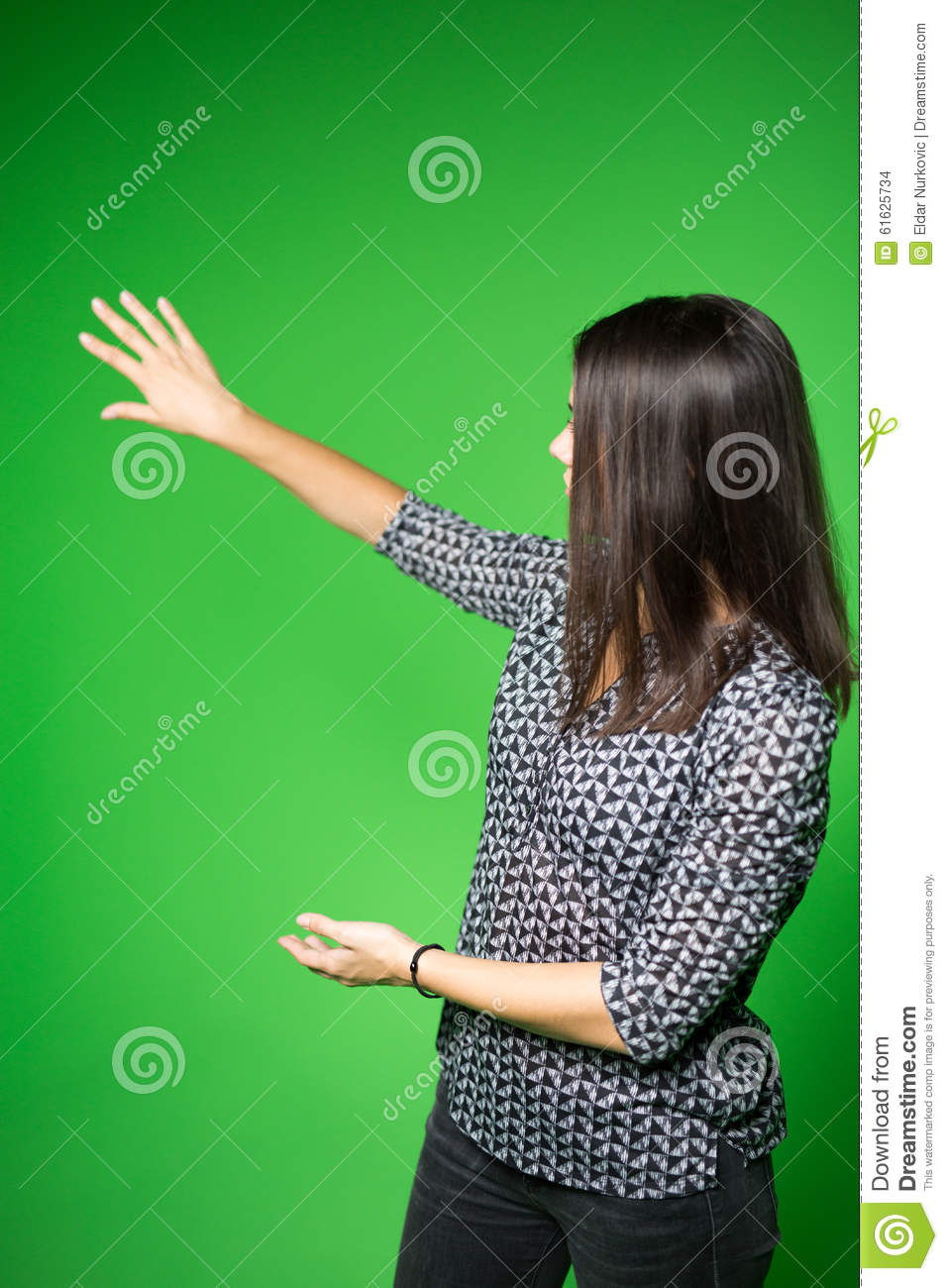 TV weather news reporter at work.News anchor presenting the world weather report.Television presenter recording in a green screen