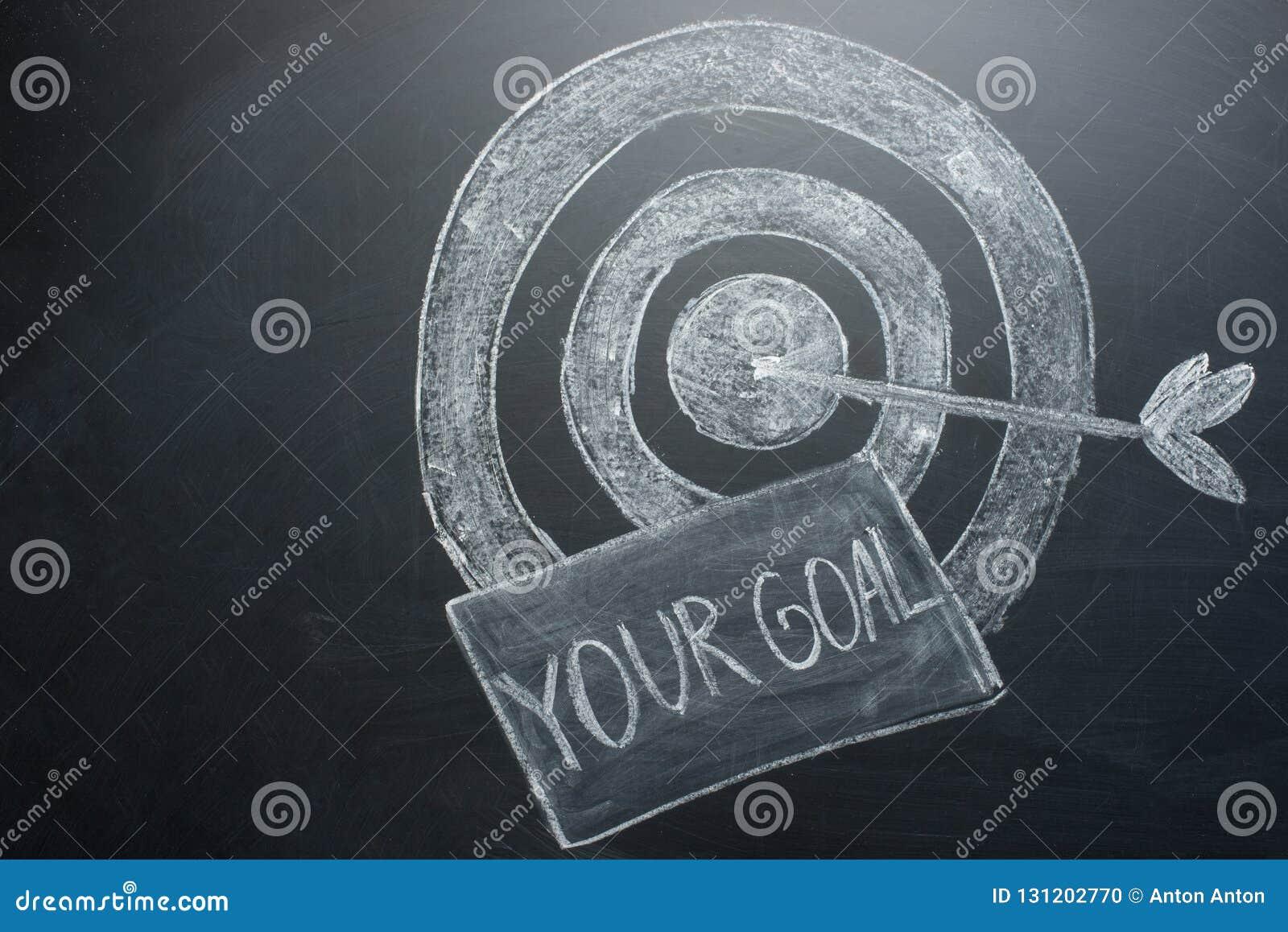Twój cel jest inskrypcją z celem na desce Pojęcie wygranie w biznesowym i dokonywać cel