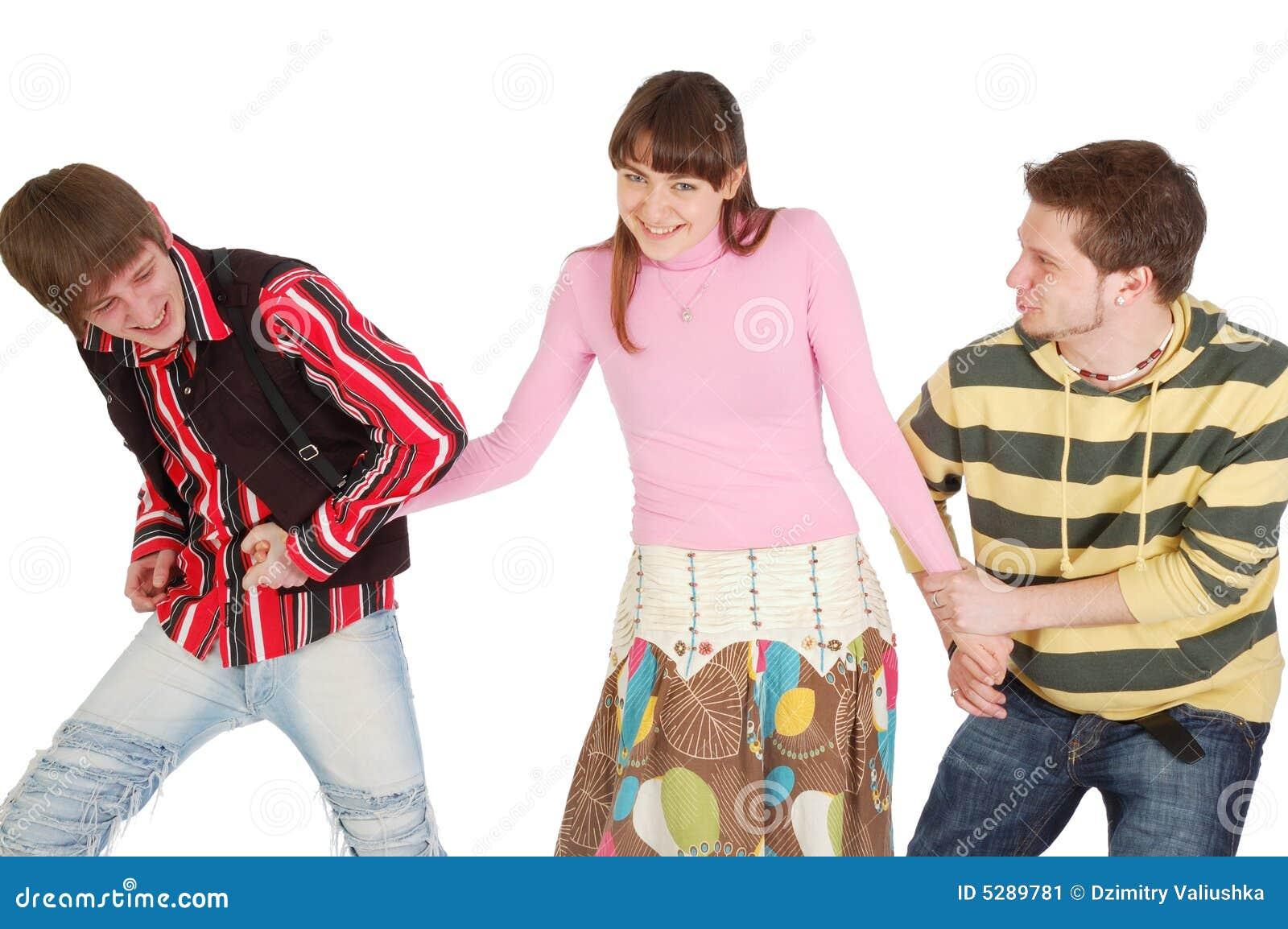 Twee jongens trekken meisje in verschillende richtingen door stock afbeelding beeld 5289781 - Twee meisjes en een jongen ...