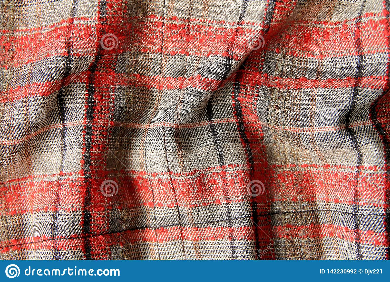 Tweed fabric in a red-gray cell crumpled