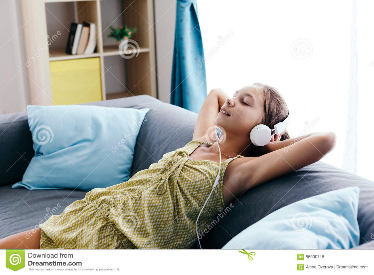 Download Tween Girl Relaxing On Couch At Home Stock Photo   Image Of Media,  Comfortable