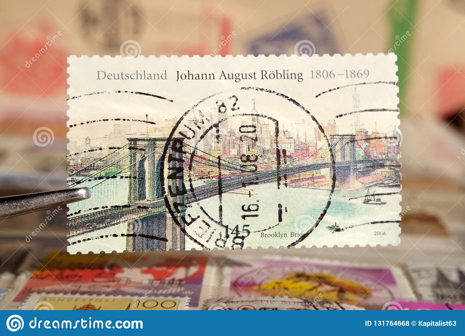 Tweezer holds postage stamp printed by Germany on topic Anniversaries, Shows Johann August