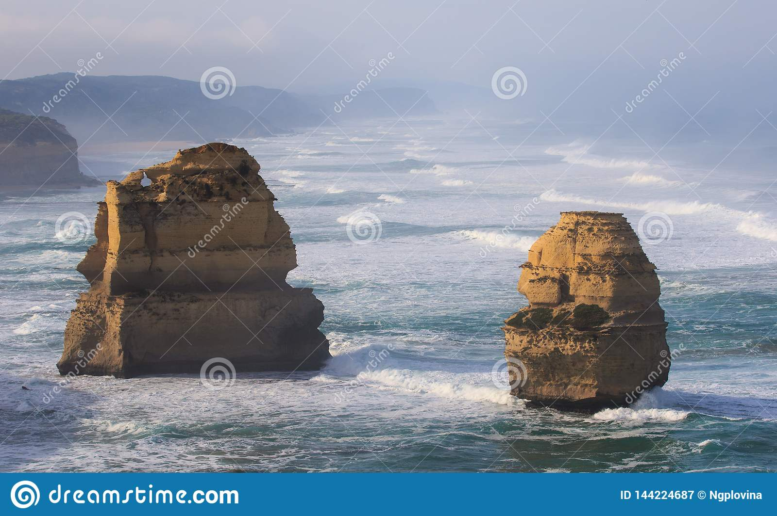 The Twelve Apostles along the Great Ocean Road, Victoria, Australia. Photographed at sunrise. Dawn fog.