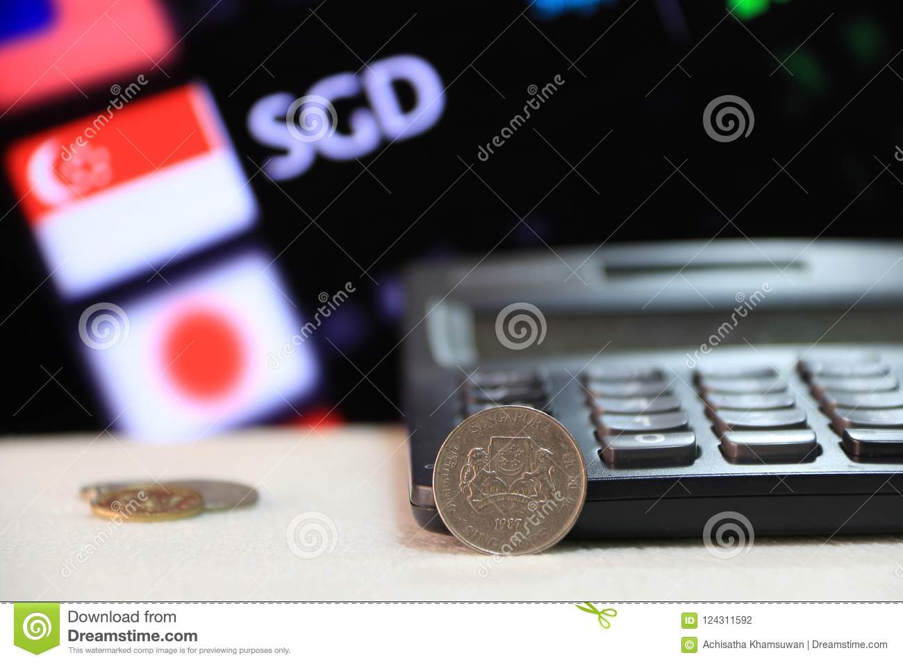 Twenty Cents Singapore Coin On Obverse Sgd With Black Calculator And Digital Board Of Currency Exchange