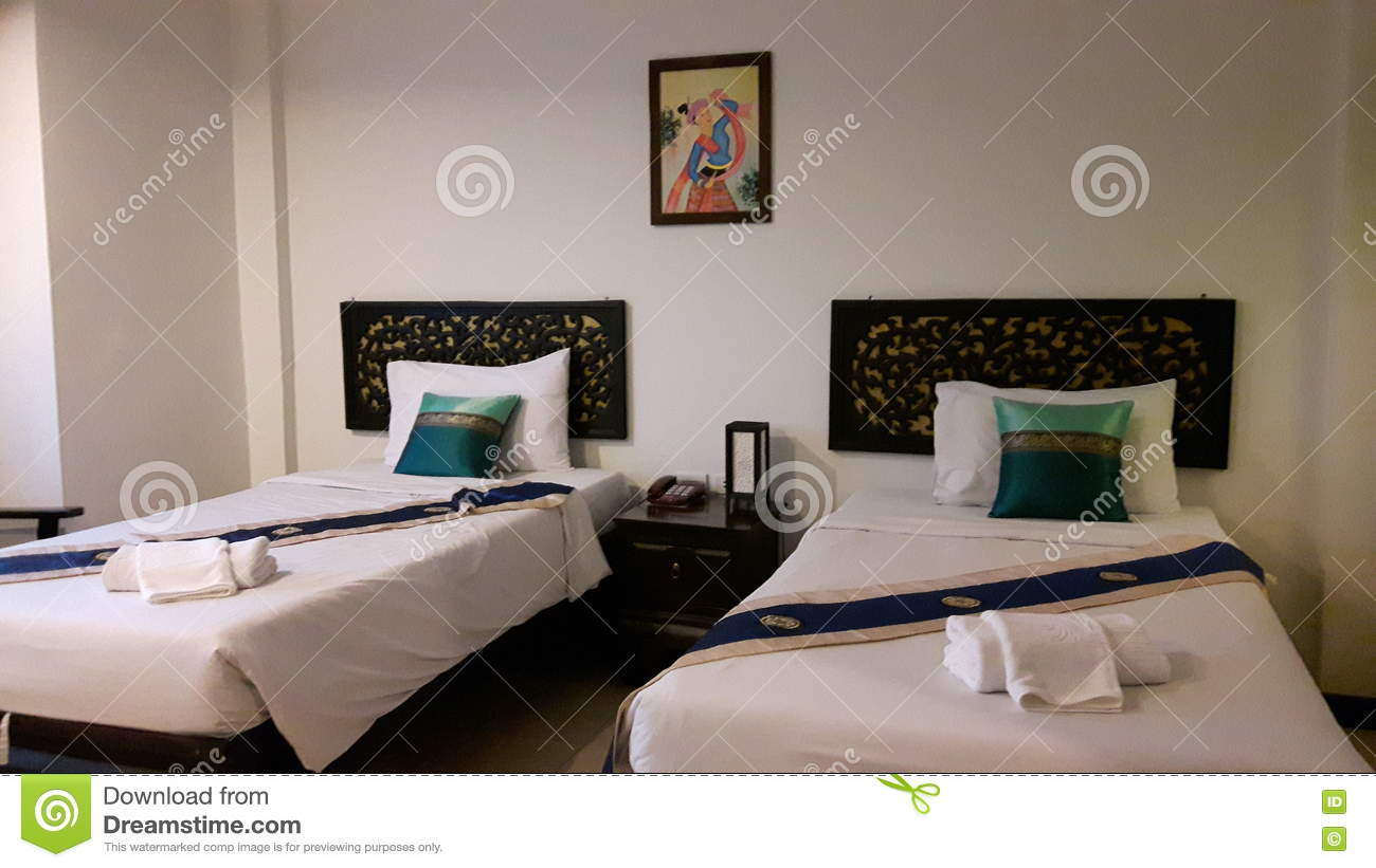 Twin Bedded Room Bed With White Bedding Decorated With Pillows And Blue Bed Runner Editorial Photography Image Of Master Bedding 70794312
