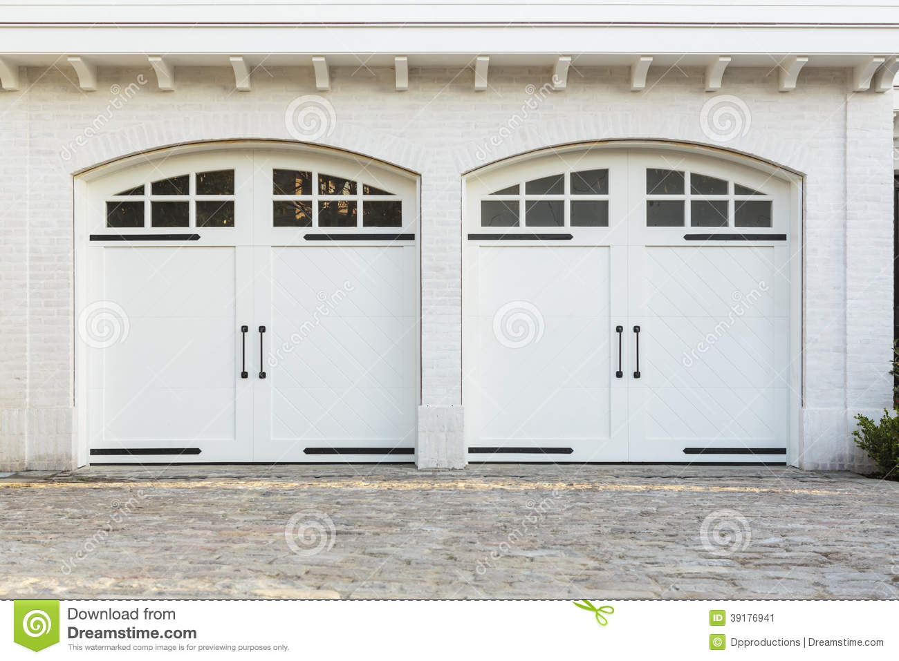 garage door hardware ideas - Twin Double Garage Doors To A White Home Stock