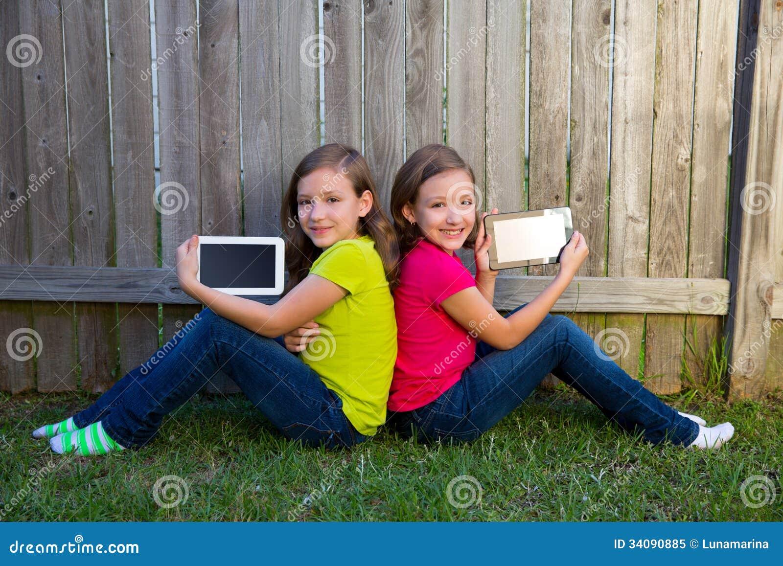 girls play in yard