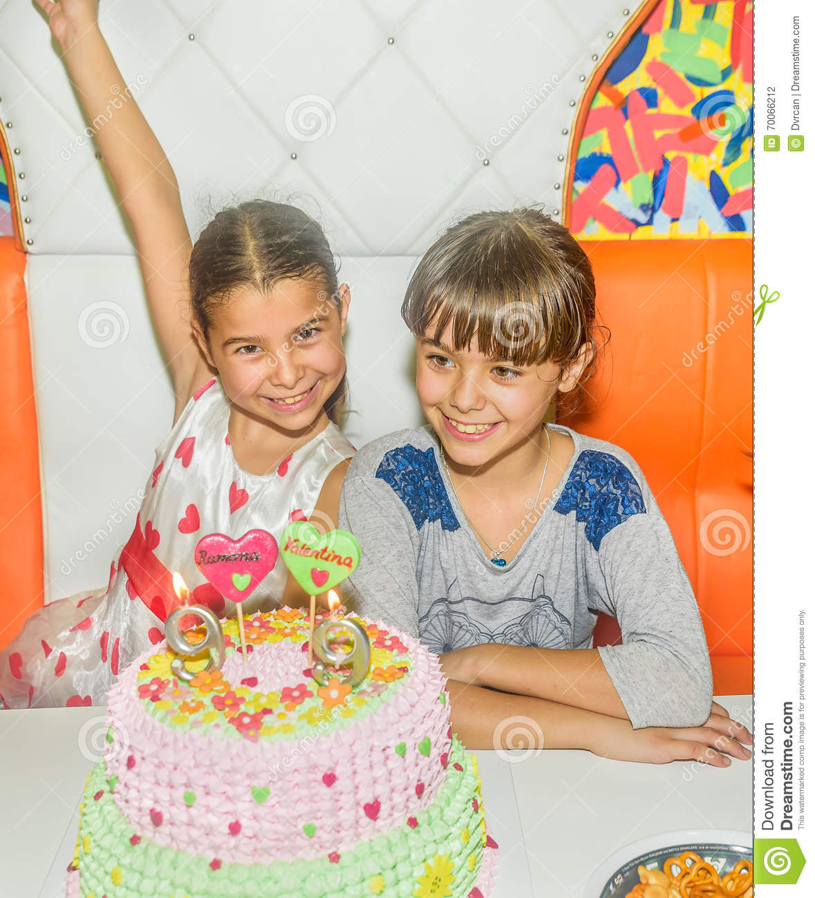 Download Twin Sisters At Birthday Celebration With Cake Stock Photo