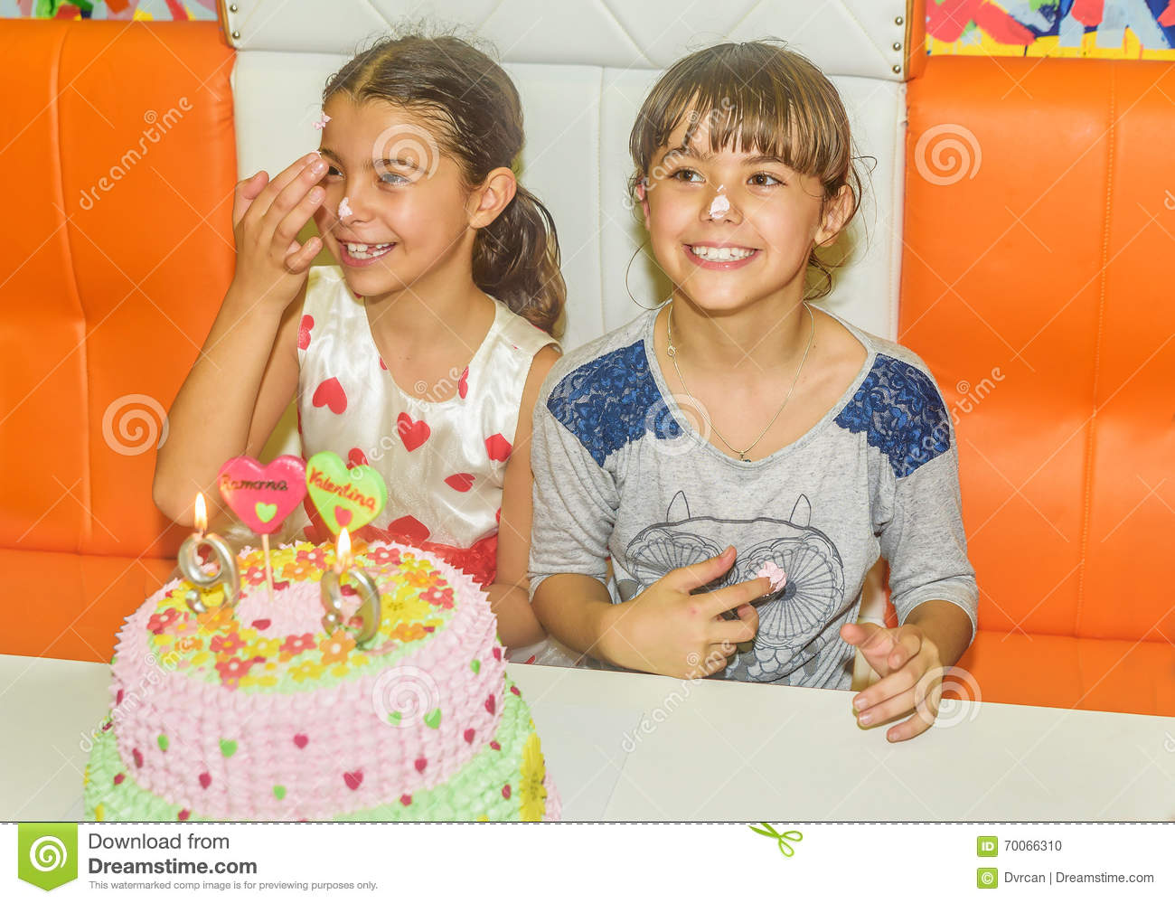 Twin Sisters At Birthday Celebration With Cake