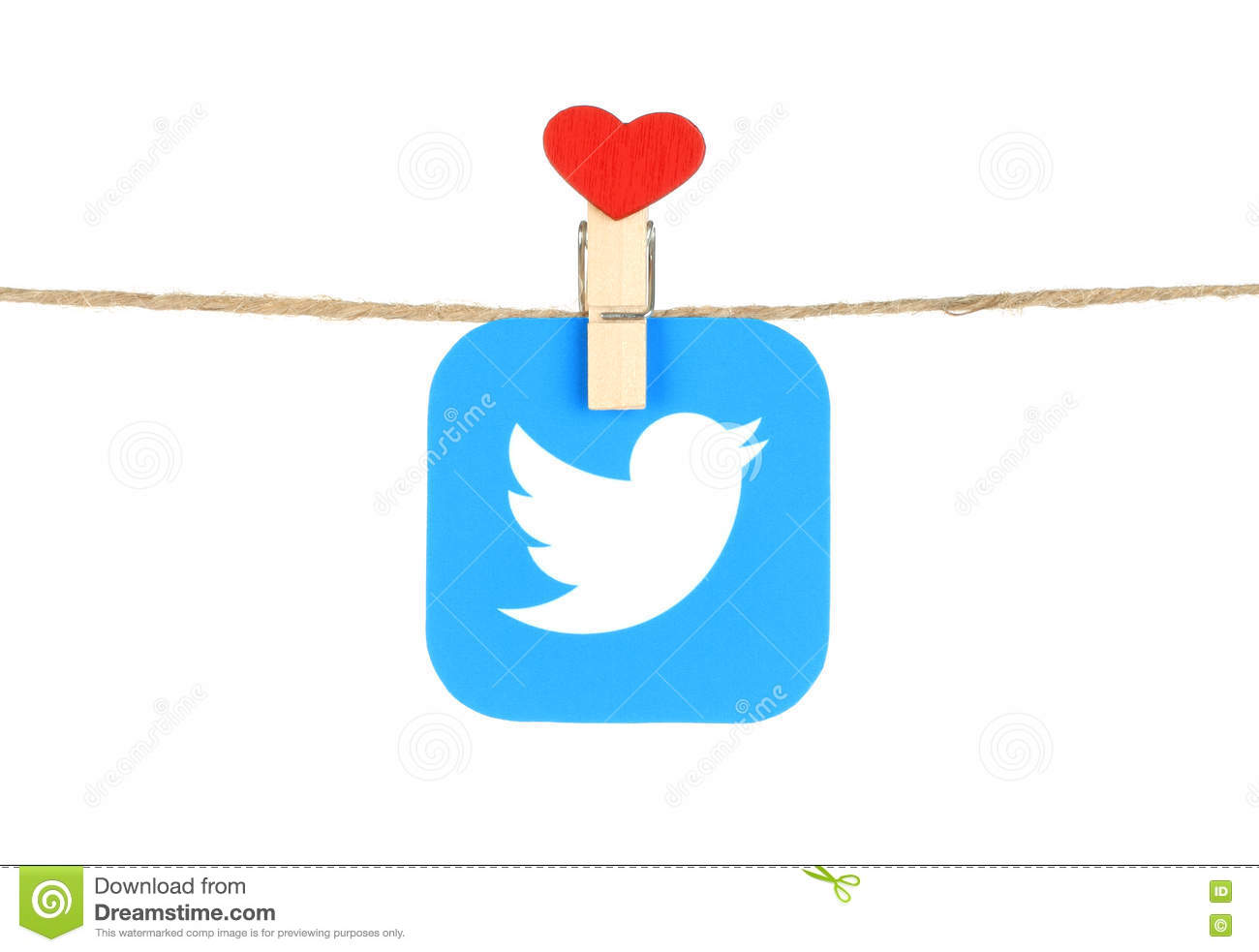 Twitter Logo Printed On Paper Hangind On A Rope With Red Heart