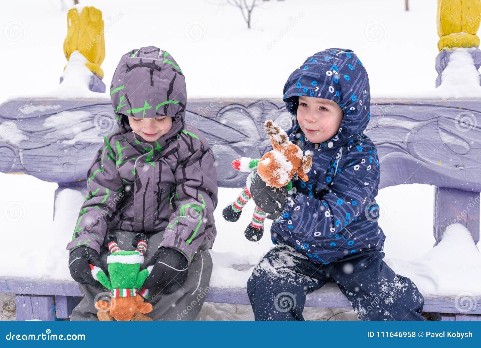 0c83f64de77c Two Adorable Preschool Kids Brother Boys In Winter Wear Sit Amoung ...