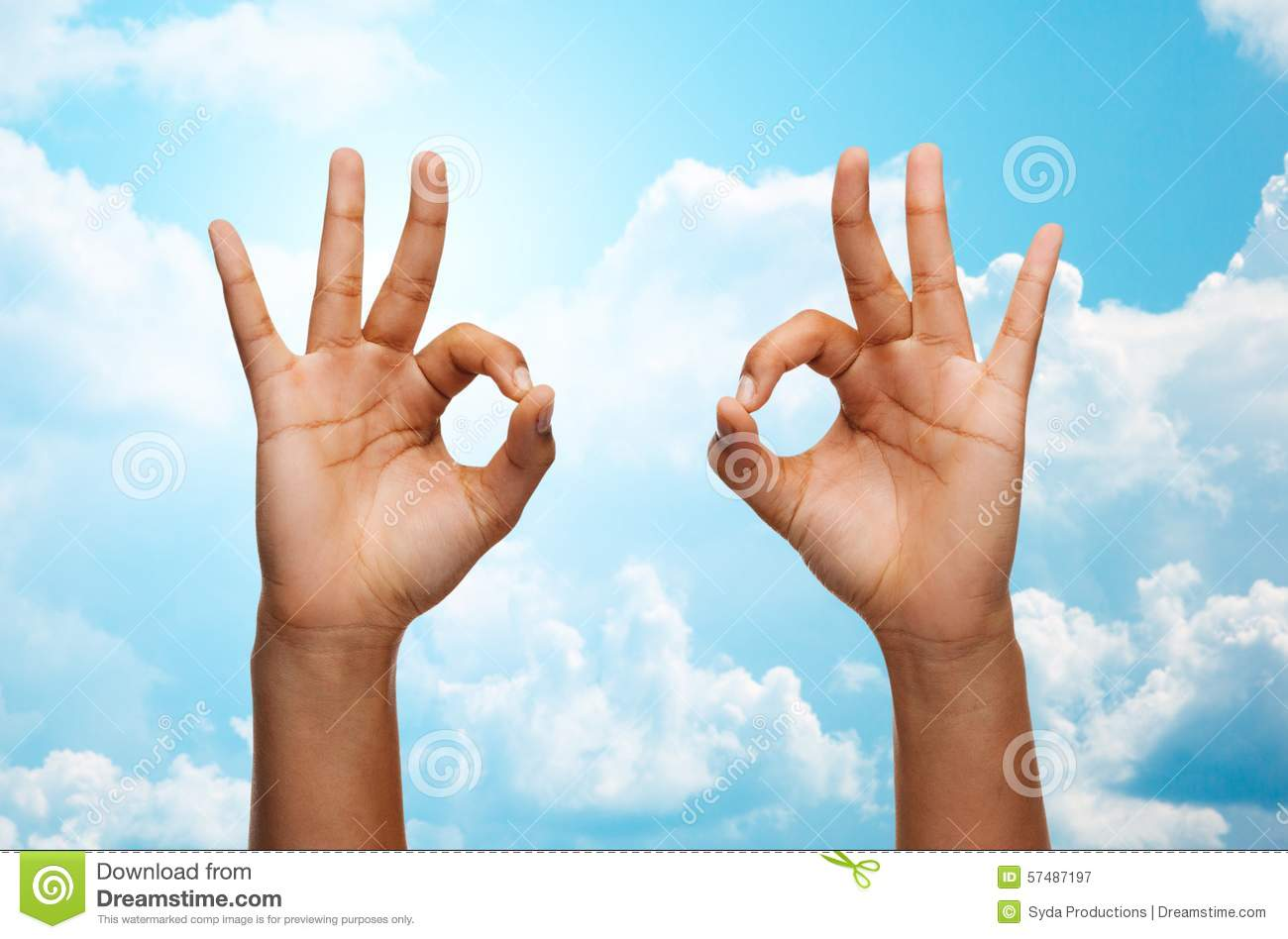 Woman Hands Showing Ok Sign Over Blue Sky Stock Photo ...