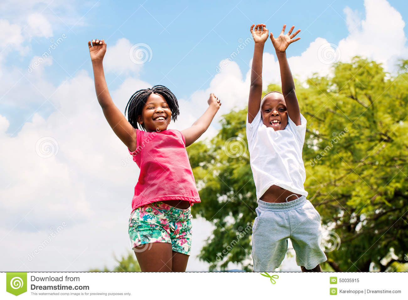 two african kids jumping in park stock image image 50035915. Black Bedroom Furniture Sets. Home Design Ideas