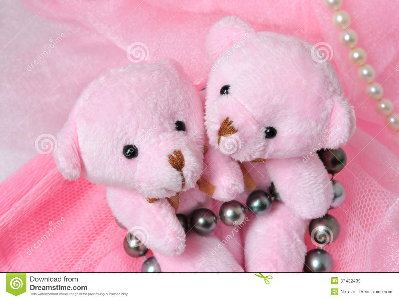 Two Amusing Pink Teddy Bear On Pink Background With Pearls