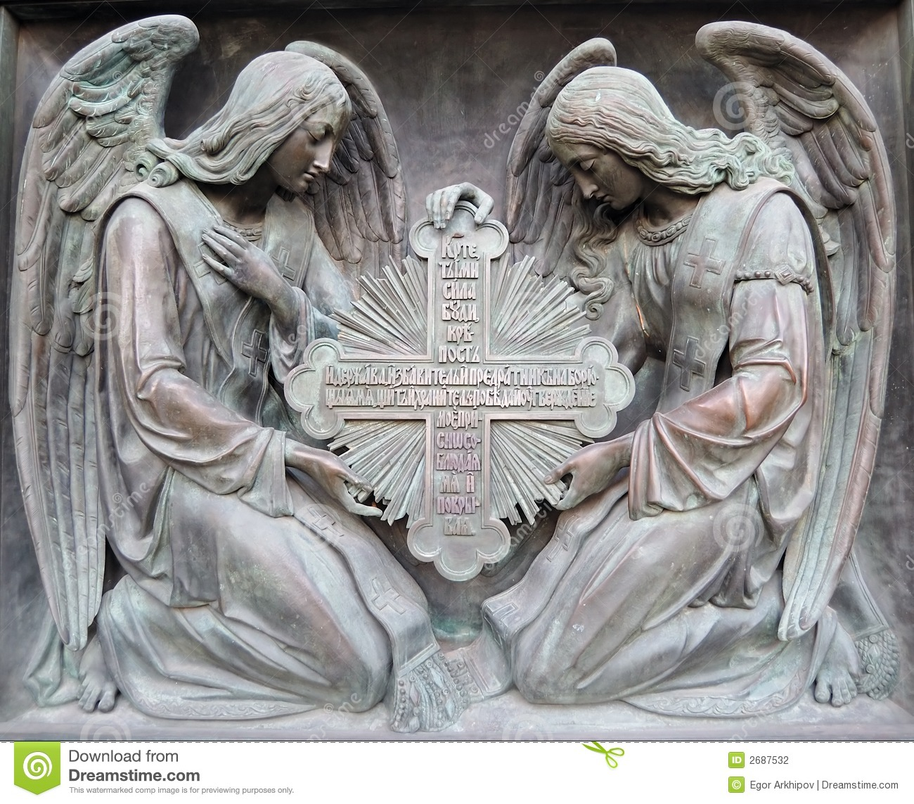 Bas-relief on a cathedral in Saint-Petersburg. Two angels hold cross.