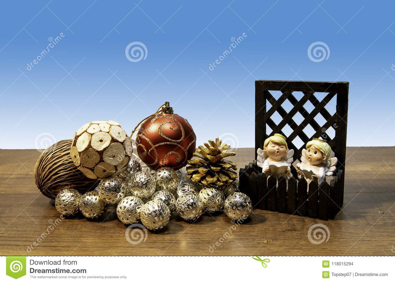 Two Angels Singing In Small Fence With Decoration Christmas Balls